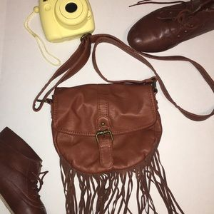 Small, Brown, over the cross body purse.